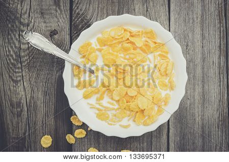 bowl of cornflakes on the old table