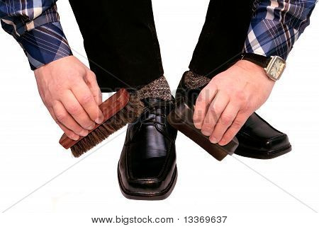 The man cleans boots