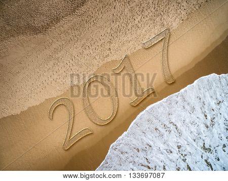 2017 written on the beach