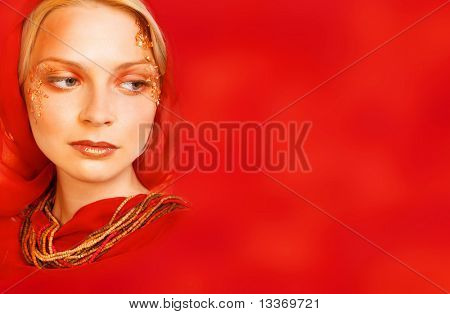 Pretty woman on red background