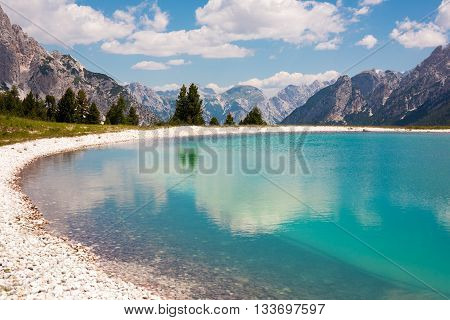 Small pond between high Peaks in the Dolomites Italy