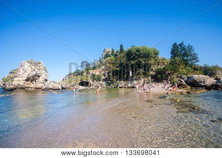 Taormina Italy - May 29 2015: Tourists enjoying the beach at Isola Bella in Sicily