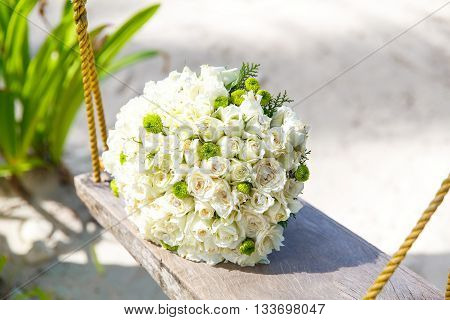 Wedding accessories. The bride's bouquet on a tropical beach.