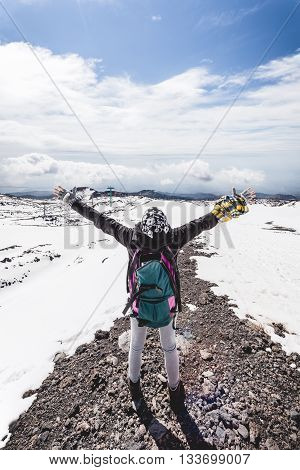 Woman at the top of the high mountain