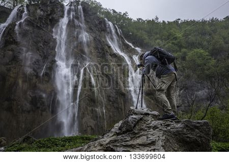 Photographer is making picture of wonderful waterfalls in Plitvice