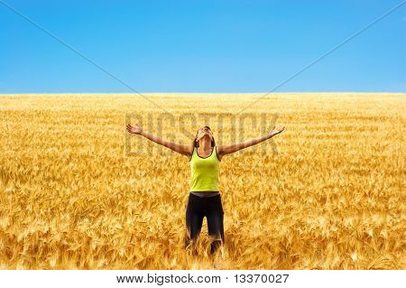 Happy young woman in the field