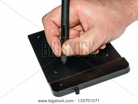Hand writing on a graphics tablet on white background