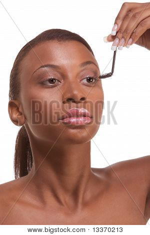 Black Woman Applying Mascara On Her Eyelashes