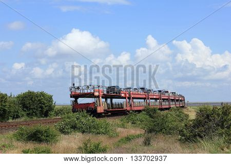 HINDENBURG-CAUSEWAY; ISLAND OF SYLT GERMANY JUNE 2016 - The Car shuttle train leaves the Island of Sylt. The Hindenburg-causeway was opened in June 1927 for nearly 90 years ago and is the most important connection between these German island and mainland