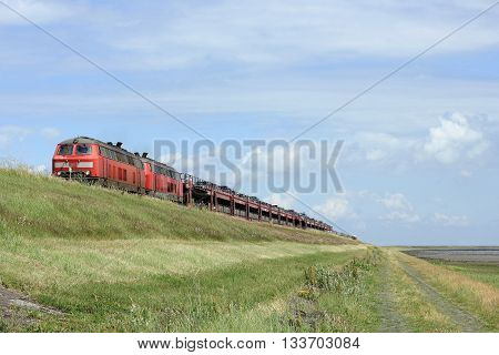 HINDENBURG-CAUSEWAY ISLAND OF SYLT GERMANY JUNE 2016 - Arrival of the Car shuttle train on the island of Sylt. The Hindenburg-causeway was opened in June 1927 for nearly 90 years ago and is the most important connection between these German island and the