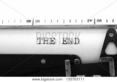 Typewriting on an old typewriter. Typing text: the end