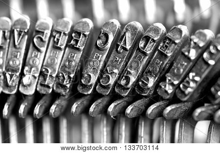 Typing. Metal types in the old typewriter
