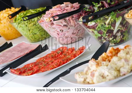 Dishes of assorted food for salad buffet in a restaurant