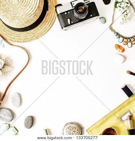 Travel kit: straw hipster retro camera map clutch. Flat lay composition for social media bloggers and travelers. overhead view