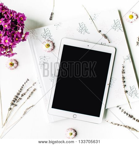 workspace. tablet lavender wedding photo album bouquet of flowers on white background. top view flat lay