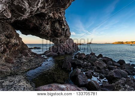 Sea Caves, Rocks And Sea View In Sardegna, Italy.