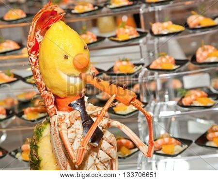 Decoration Made With Lobster, Lemon And Carrot.