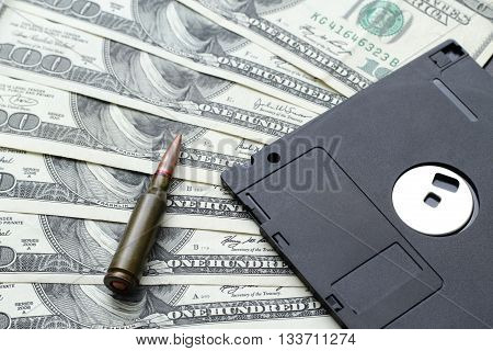 Military Information Concept: Bullet and Floppy Disk on Dollar Banknotes