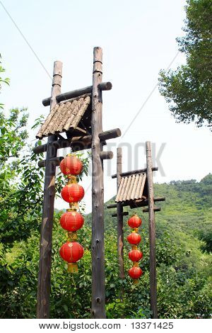 Red Lanterns In Green Trees In A Scenic Spot