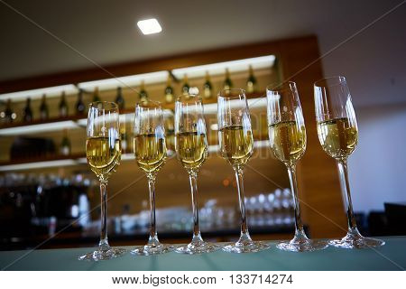 A row of champagne glasses. Shallow dof