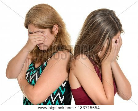 Family problems, Teenager conflict - Mother and her teenage daughter both crying - Isolated on white