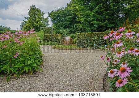 A path of gravel surrounded by a flowery border