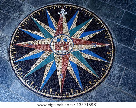 Beautiful compass directions wind rose made from colorful mosaic stones