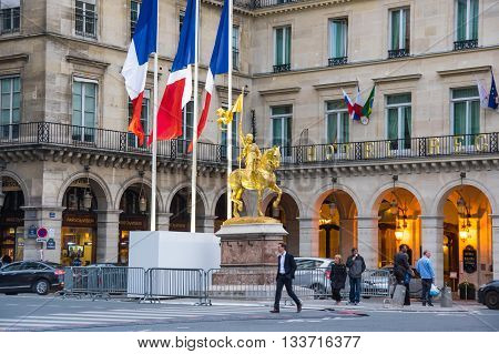 PARIS FRANCE - MAY 07 2015: Jeanne D'Arc Statue on Rue de Rivoli in the historical center of Paris in the dusk France