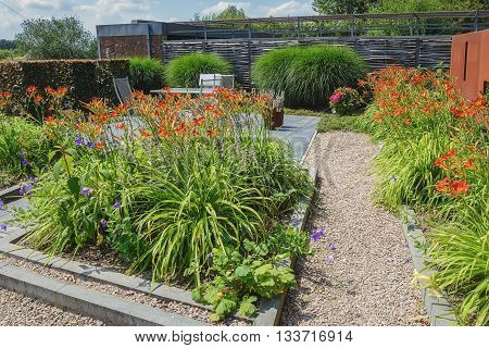 Decorative garden path surrounded by flowering plants.