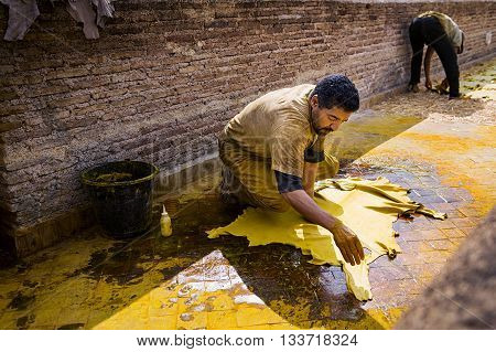 Fez Morocco - April 11 2016: One man working in a tannery in the city of Fez in Morocco.