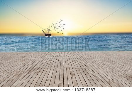 Ship on sea , beautiful sunset on background