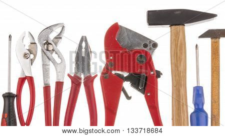 a lot of old second-hand reliable tools on an isolated white background
