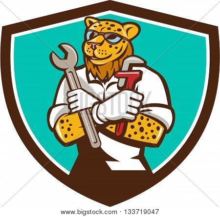 `Illustration of a leopard mechanic holding spanner and monkey wrench with arms crossed viewed from front set inside shield crest on isolated background done in cartoon style.