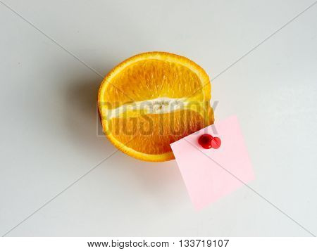 Orange fruit on white background with label.