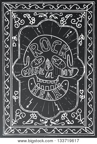 Rock music in my heart. Hand drawn lettering design with skull and frame on black chalk board. Typography concept for t-shirt design or web site.