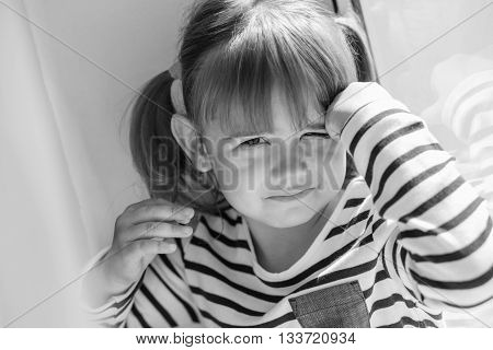 portrait of a little girl upset window ( black and white )