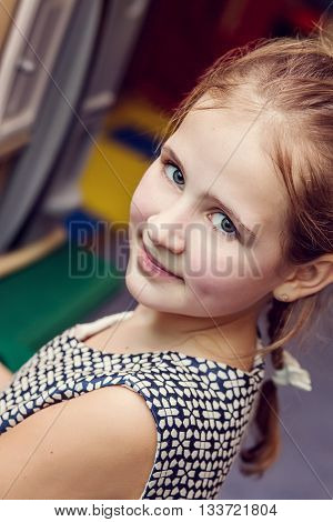 Portrait of a cute little girl in the room