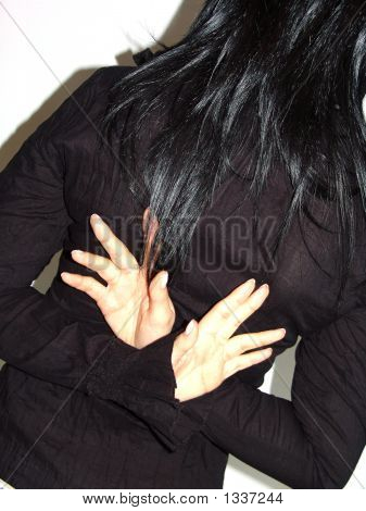 Young Woman Backwards Whith Cross Hands
