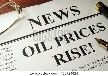 Newspaper with header news and Oil prices rise.