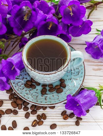 Cup Of Coffee, Coffee Beans And Lilac Flowers