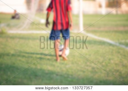 blurry Children without shoes Playing football (soccer)