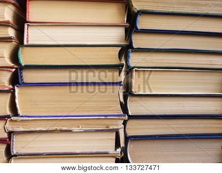 Many old books in a book shop or library,  education and reading concept