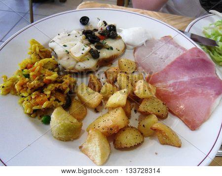 Mediterranian food potato and rice and meat on Malta