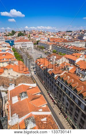 Lisbon Portugal city skyline over Santa Justa Rua.