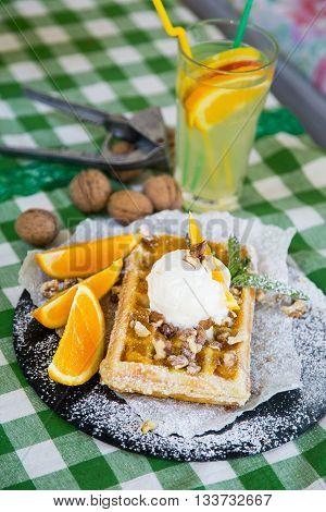 Belgian Waffle With Honey Sauce, Oranges, Walnuts, Ice Cream And Mint With Fresh Lemonade