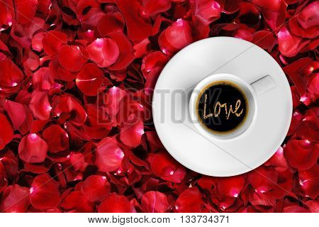 detail of great italian espresso coffee in a white cup top of view with foam love word shape time to love on roses petals background