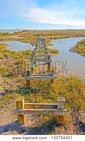 Abandoned Pier on a Remote Shore in the Aransas National Wildlife Refuge on the Gulf Coast of Texas