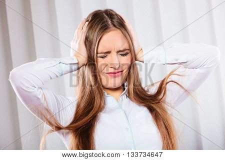 Stressed Woman In White Shirt With Headache