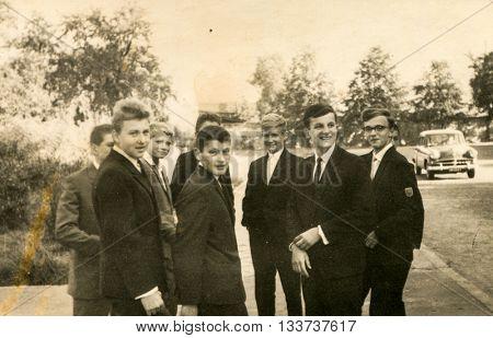 LODZ, POLAND, CIRCA 1960's: Vintage photo of group of schoolmates outdoor