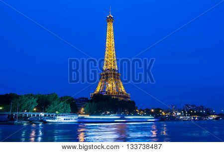 Paris; France-June 10 2016 : The Eiffel tower is a wrought lattice tower on the bank of Seine river in Paris.The tower is the tallest structure in Paris and the most visited monument in the world.